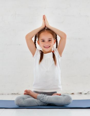Young girl in a yoga pose